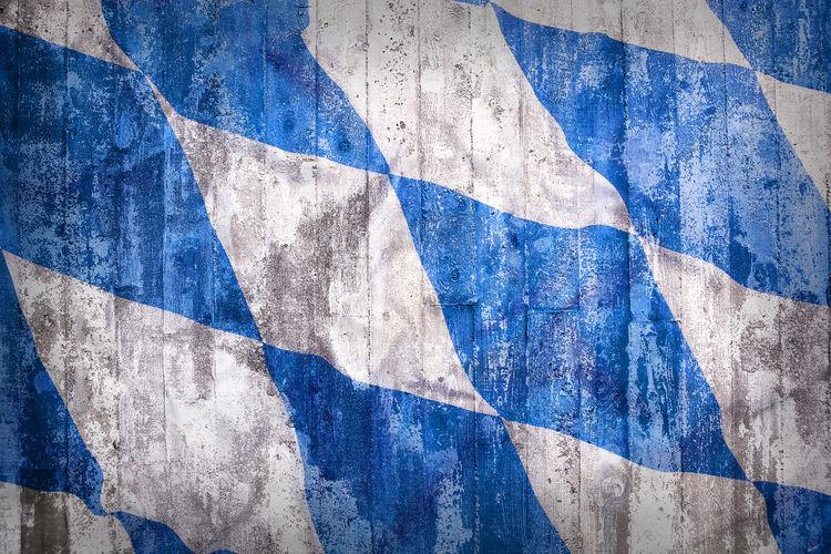 Full frame shot of grunge bavarian flag on wooden wall