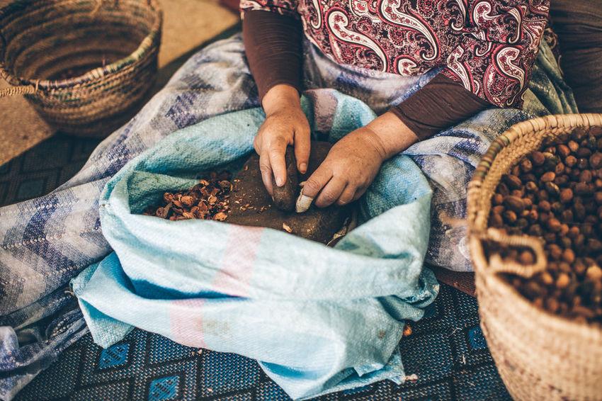 argan oil hand made women around the world Women Hands Argan Nuts ArganOil Handcraft Handmade Canon5dmarkiii Canonphotography Culinary Amazigh Argan EyeEm Selects Human Hand Sack Women Basket High Angle View Sitting Close-up