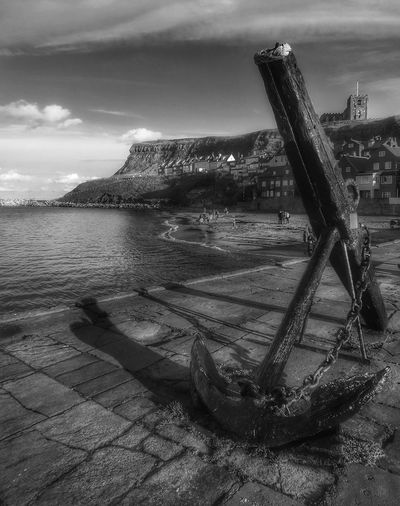 The Anchor at Tate hill pier Whitby Beach Outdoors Cloud - Sky Sea Back & White Monochrome Photography Whitby View Pier Whitby North Yorkshire The World Through My Eyes Creative Light And Shadow Malephotographerofthemonth North Yorkshire Coast Travel Destinations Built Structure Architecture Anchor - Vessel Part Pier Photos Black And White Friday