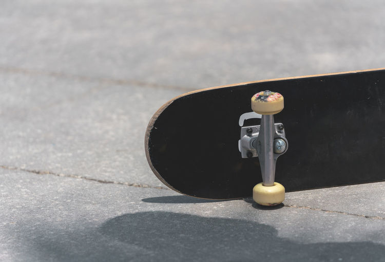 Closeup of skateboard Personal Accessory Close-up Sunlight Street Single Object Sunny Day Shadow No People Skateboard Skateboarding Skateboard Park Vscocam VSCO Los Angeles, California Landscape Urban Skyline Streetphotography Street Scene
