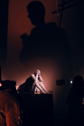 Silhouette people at illuminated nightclub