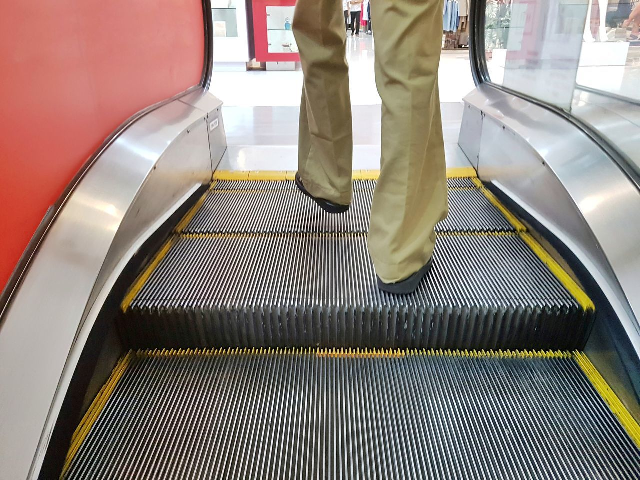 escalator, transportation, convenience, moving walkway, staircase, steps and staircases, indoors, real people, technology, one person, lifestyles, railing, futuristic, human leg, modern, standing, men, human body part, low section, body part