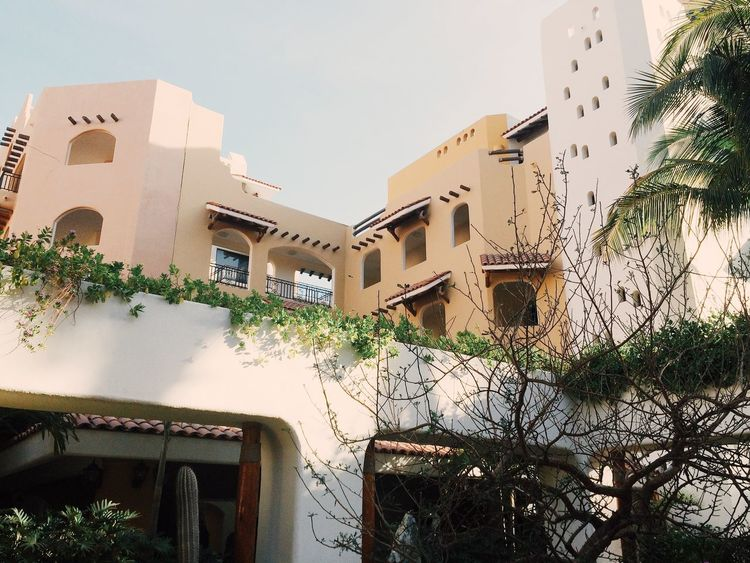 Buildings in the city City Desert Mexico Architecture Balcony Building Exterior Built Structure Day House Low Angle View No People Outdoors Residential Building Whitewashed Window