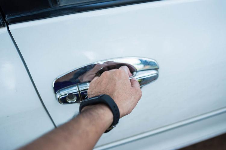 Cropped Hand Of Man Opening Car Door