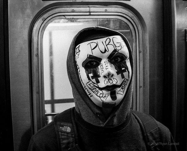 "PURGE - ""I trust no one, not even myself"" - Stalin RLX NYC Bronx Street Photographer Subway Pentax QS1 01LENS Purge Mask Halloween Eyes Stare Quote Kid"