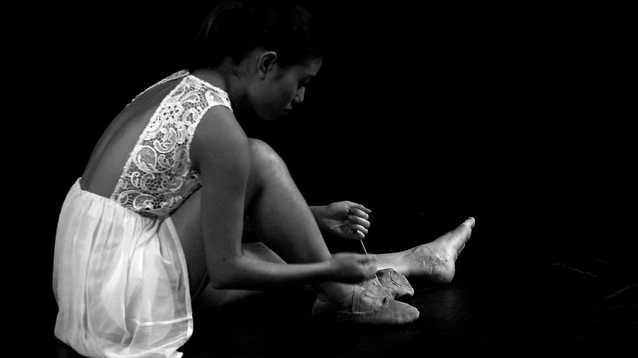 Ballet Dancer Ballet Shoes Black Background Day Full Length Human Hand Indoors  Lifestyles One Person People Real People Side View Sitting Standing Studio Shot Young Adult Young Women