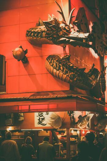 Statue in illuminated room