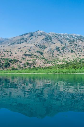 Lake Kournas Water Beauty In Nature Scenics - Nature Sky Tranquility Blue Plant Lake Mountain No People Nature Clear Sky Waterfront Reflection Outdoors Idyllic Tranquil Scene