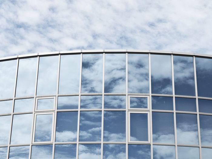 Reflection Of Sky On Modern Building