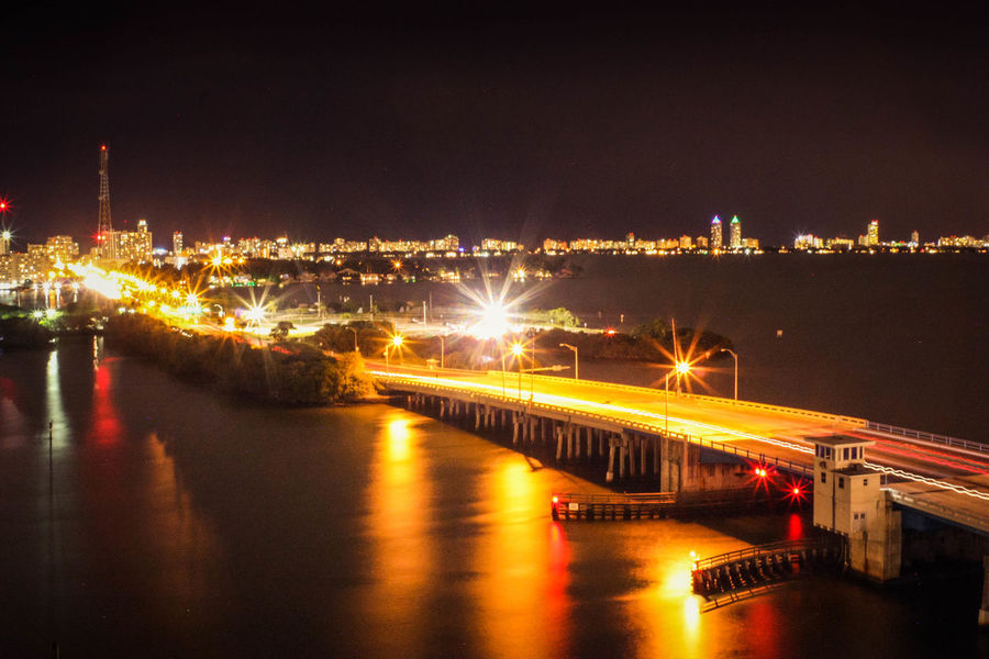 Long exposure night shot of a draw bridge with cars creating light streaks across it's surface in Miami, Florida. Architecture Bridge Bridge - Man Made Structure City City Life Connection Dark Engineering High Angle View Illuminated Long Exposure Long Exposure Shot Night Night Photography No People Ocean Outdoors Reflection Sea Streaking Car Lights Streaking Light Streaks Of Light Transportation Water Waterfront