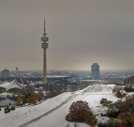 Tower and buildings in city during winter