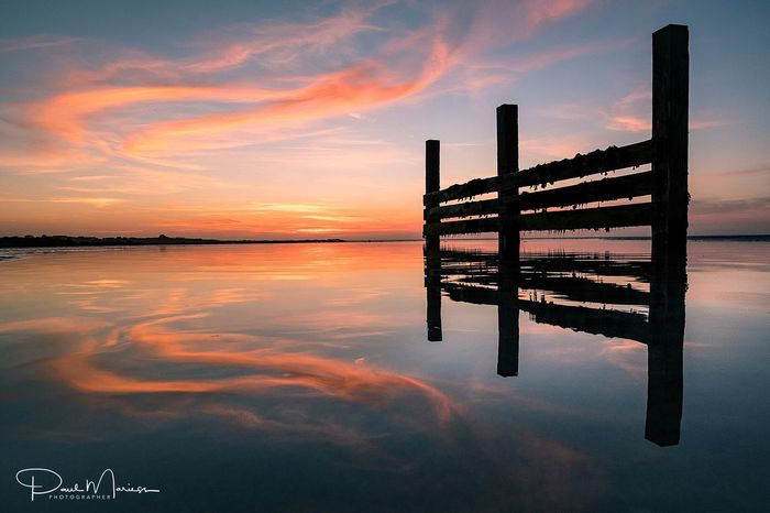 Sunset Reflected.. Reflection Water Sky Sunset Beauty In Nature Tranquility Symmetry Silhouette Cloud - Sky Eye4photography  EyeEm Best Shots Guernsey Sea And Sky Landscape_Collection