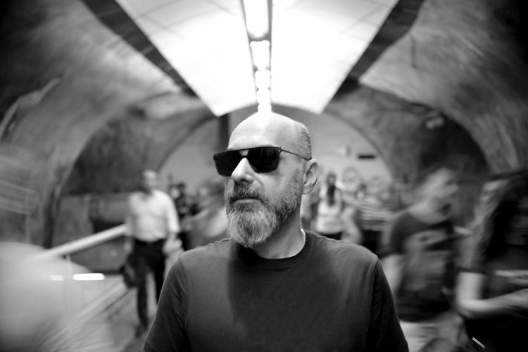 The Architect - 2019 EyeEm Awards EyeEm Best Shots Eye4photography  Getting Inspired My Best Photo Underground Notes From The Underground The Portraitist - 2019 EyeEm Awards Real People Indoors  One Person Portrait Blackandwhite Monochrome Lifestyles Men Front View Incidental People Focus On Foreground Facial Hair Leisure Activity Adult Beard Males  Headshot Casual Clothing Glasses Mid Adult Men Looking At Camera Ceiling Slow Shutter