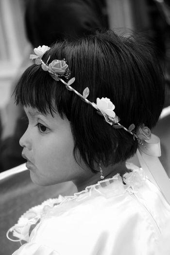 Close-up portrait of girl wearing tiara