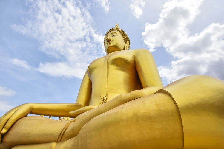 great buddhists in thai&blue sky Sky Large Male Likeness Sculpture Religion Belief Representation Gold Colored Statue No People Idol Spirituality Human Representation Cloud - Sky Buddha Thailand Buddhism Ancient