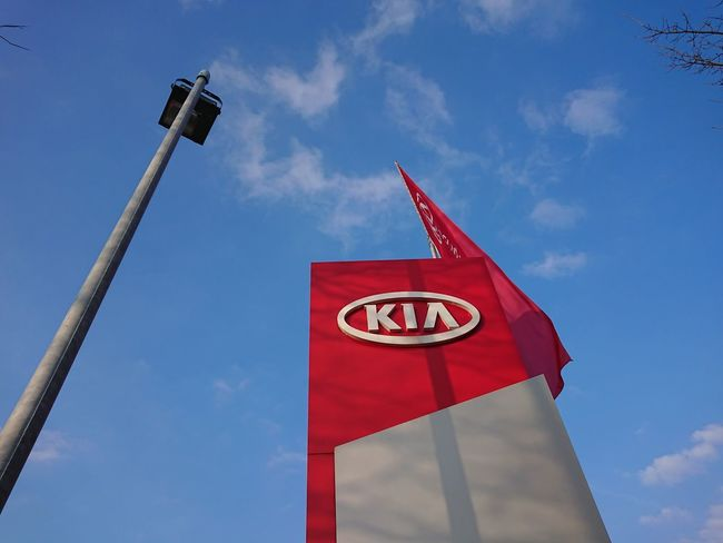 Berlin, Germany - March 25, 2018: Kia car dealership. Kia Motor Corporation headquartered in Seoul, is South Korea's second-largest automobile manufacturer Car Dealership Kia Kia Motors Korean Banner Brand Dealership Editorial  Low Angle View Manufacturer No People Outdoors Red