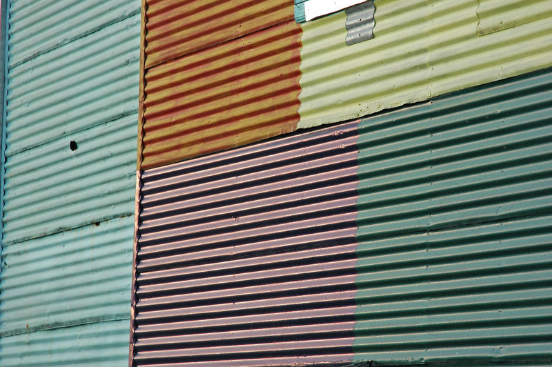 Architecture Backgrounds Building Exterior Built Structure Closed Corrugated Corrugated Iron Day Full Frame Garage Green Color Iron Metal Multi Colored No People Outdoors Pattern Shutter Striped Textured  Wall Wall - Building Feature Window