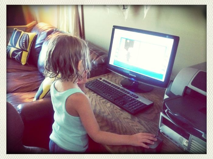 gettin' her 20 minutes in for her summer reading program:-) Tumblebooks.com has audio books you follow along on and it counts as reading per the NL Library. I still read to her also but I like to mix it up.........and clean......he he he