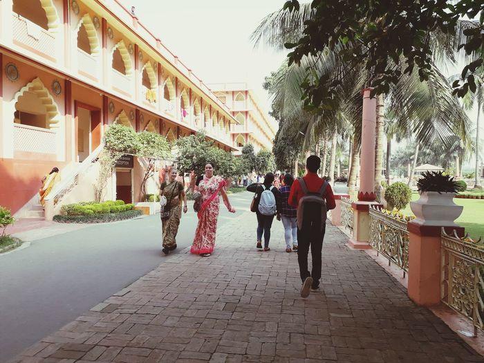 Group of people walking on footpath