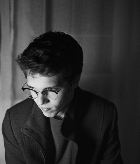 Analogue Photography Artist Black & White Blackandwhite Day Eyeglasses  Film Photography Indoors  Kodaktmax400 Looking Down Manfashion Manfashionstyle Oldfashioned One Person People Portrait Portrait Photography Real People Tensed Tmax Young Adult