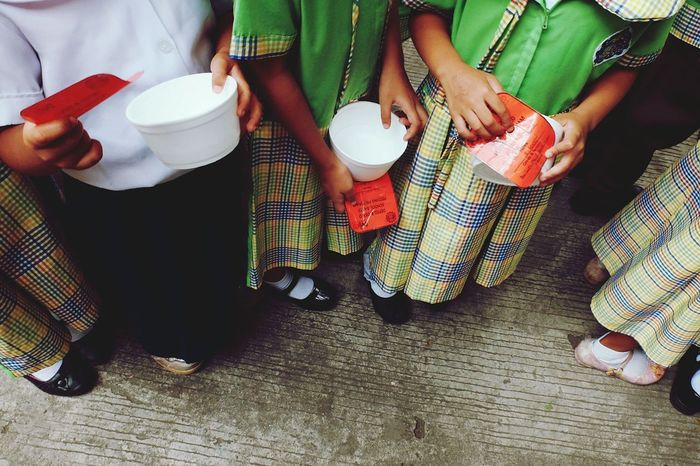 Holding Midsection Low Section Close-up Hands Feeding  Students Body Part Uniform Uniforms Children Child Childrenuniform School Uniforms Around The World School School Life  School Uniform Kid Kids Kids Being Kids Hold Outdoors Lifestyles Christmas Around The World Day