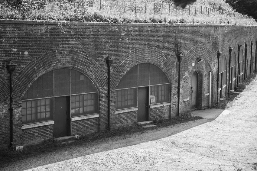 Hilsea Lines Ramparts Bastion 3 Ancient Monument Arch Architecture Architecture Archway Bastion Bastion 3 Black And White Blackandwhite Building Built Structure Closed Day Diminishing Perspective Fortifications HDR Hdr_Collection Hilsea Hilsea Lines Hilsea Lines Ramparts No People Outdoors Repetition Side By Side Walkway