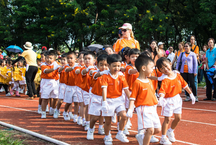 Adult Boys Child Childhood Competition Day Full Length Large Group Of People Leisure Activity Men Outdoors People Real People Sport Sports Clothing Standing Student Togetherness Tree Uniform