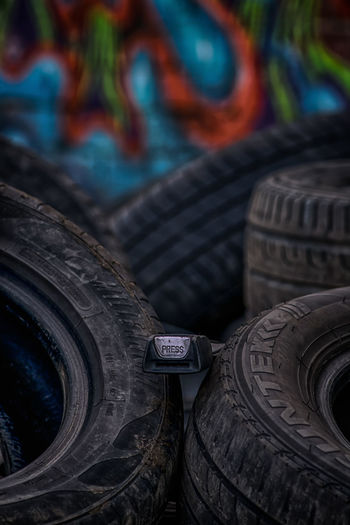 Press on! Seat Belt Buckle Press No People Outdoors Tyres Tires Depth Of Field HDR Lights And Shadows Creativity Creative Photography Focus On Foreground Urban Exploration Colourful Multi Colored Still Life Industrial Large Group Of Objects Scrap Yard Car Vehicle Close-up Graffiti Architecture