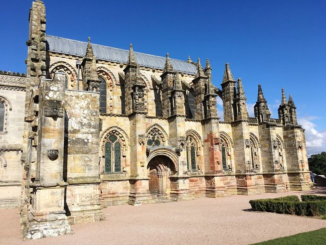 Rosslyn Chapel Religion Architecture Built Structure Spirituality Day Place Of Worship Arch Outdoors History Building Exterior Travel Destinations Clear Sky No People Blue Sky