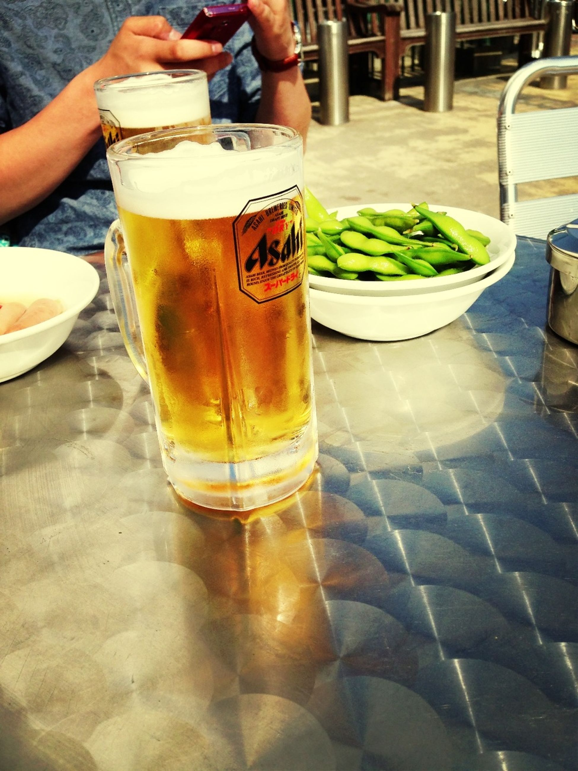 drink, food and drink, refreshment, drinking glass, freshness, table, alcohol, restaurant, frothy drink, indoors, lifestyles, juice, healthy eating, incidental people, drinking straw, close-up, coffee - drink, beer glass