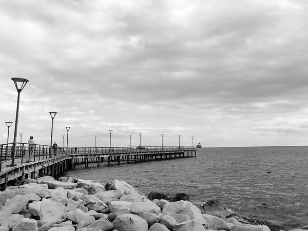 Beauty Shapes Clouds Rocks Waves Sea Walking People Wharf Pier Sky Sea Water Cloud - Sky Beach Horizon Over Water Horizon Scenics - Nature Beauty In Nature Day Land Tranquil Scene Street Nature Street Light Tranquility No People Outdoors Pebble Groyne