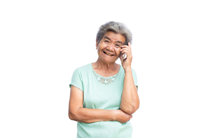 Happy Missing Connection Holding One Person Senior Adult Smart Phone Smiling Standing Talking Technology Using Phone White Background Women
