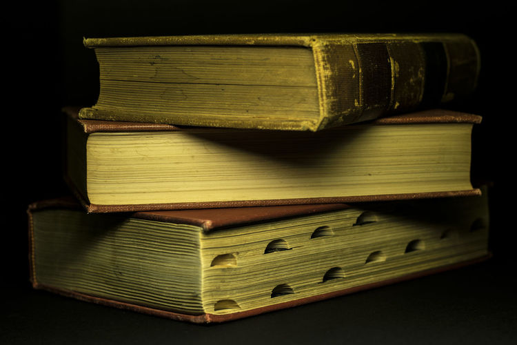 Close-up of books against black background