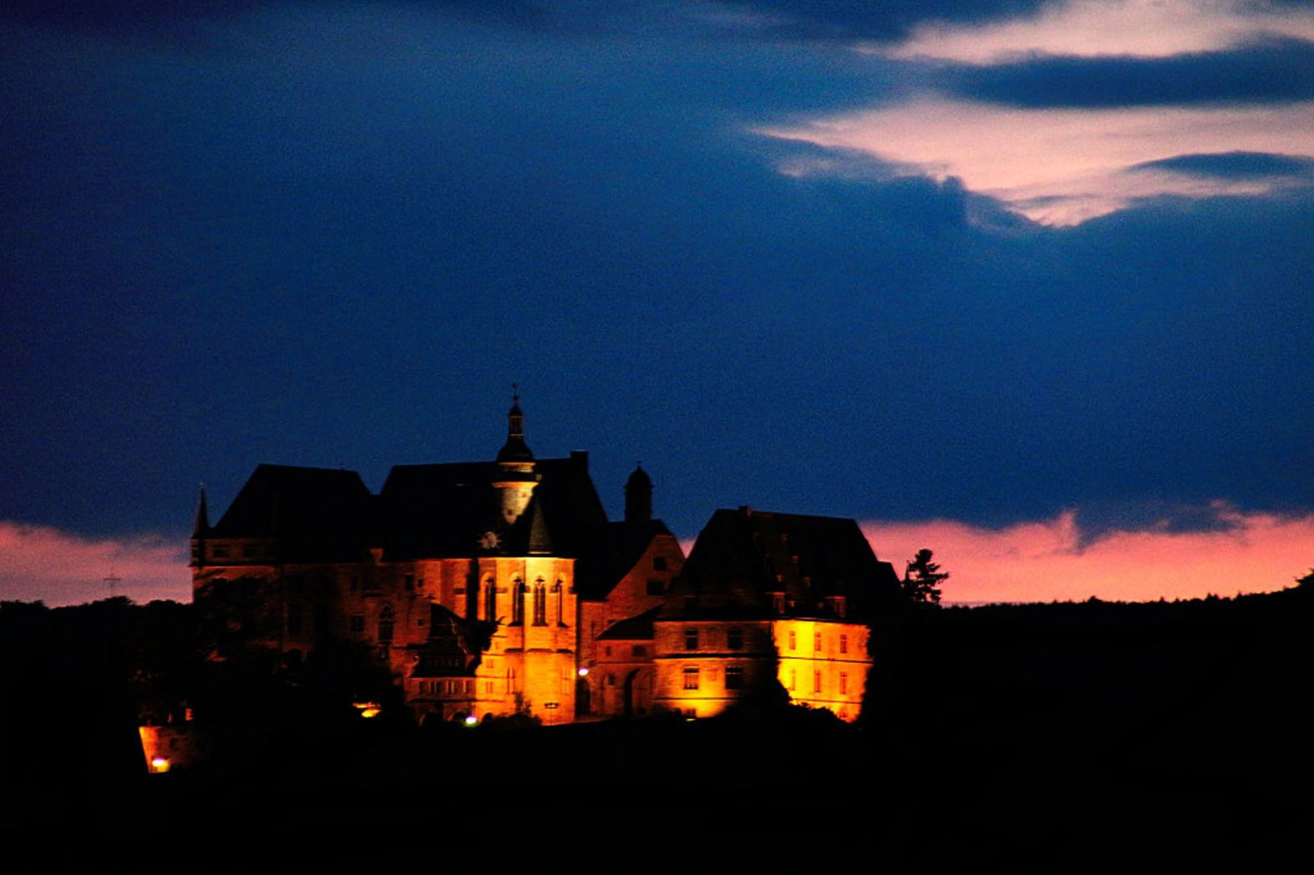 architecture, built structure, building exterior, sunset, silhouette, sky, place of worship, church, cloud - sky, religion, spirituality, dusk, house, low angle view, orange color, outdoors, dark, cloud, no people