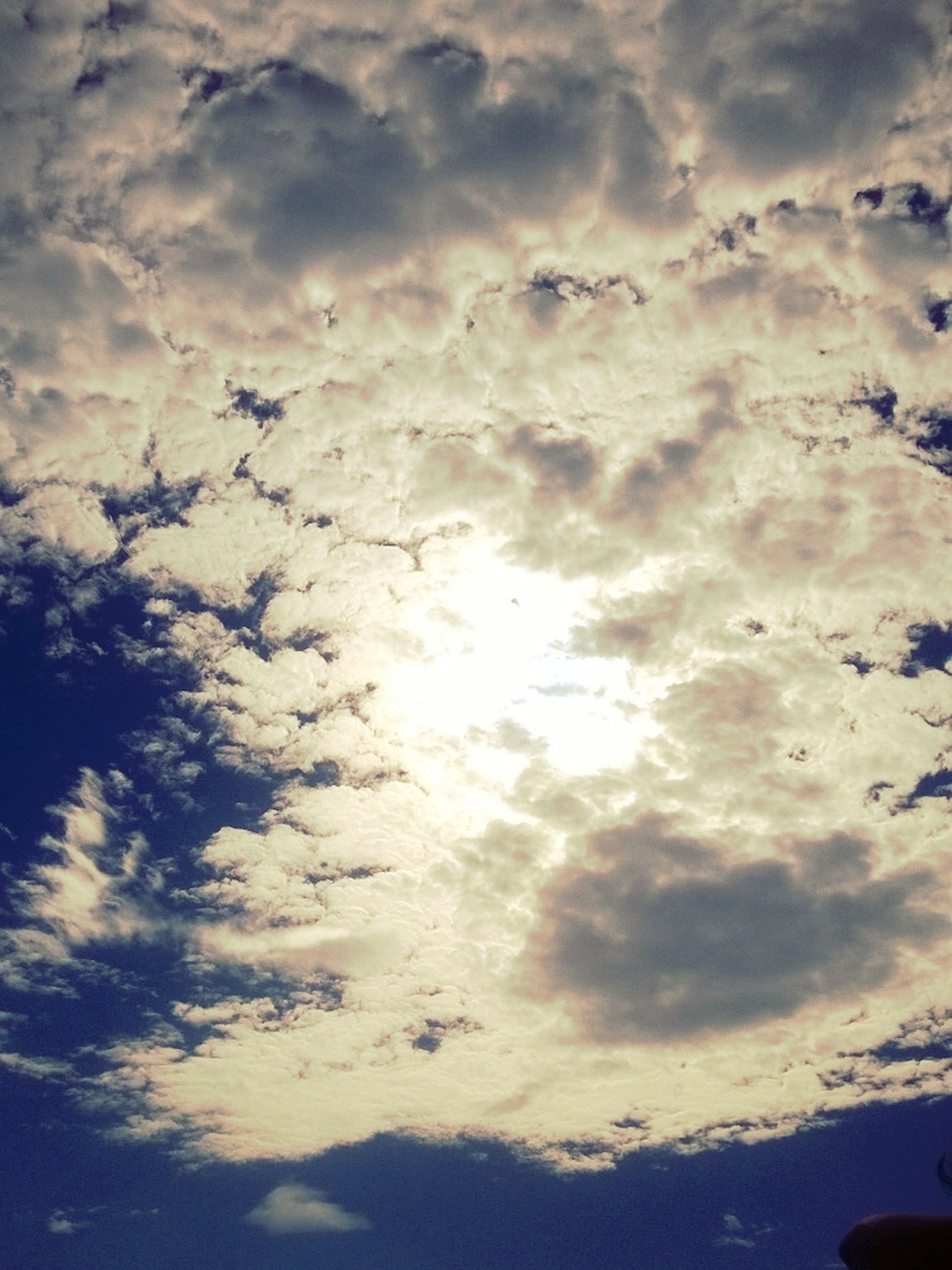 sky, cloud - sky, cloudy, beauty in nature, tranquility, scenics, tranquil scene, low angle view, weather, nature, cloudscape, silhouette, cloud, sunset, idyllic, dramatic sky, overcast, outdoors, no people, sunlight