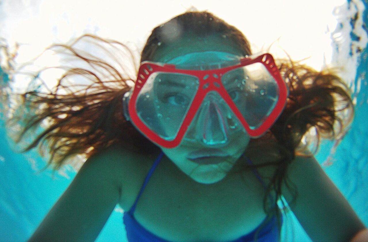 Portrait of woman wearing swimming goggles