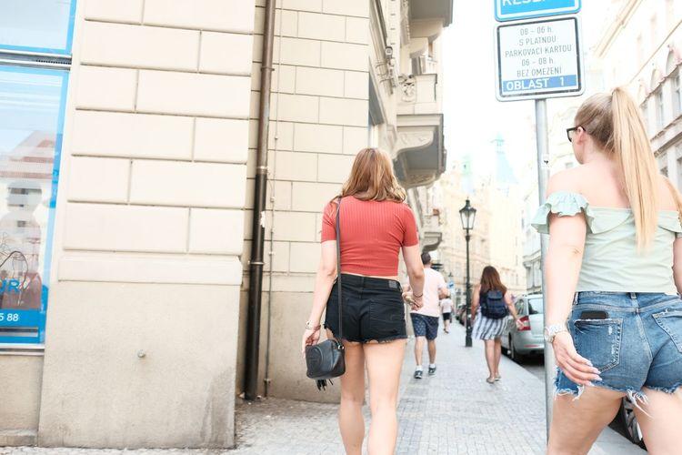 Rear view of women walking in city