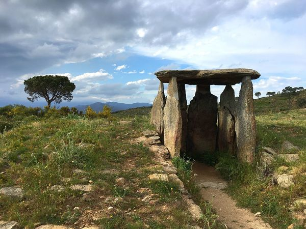 Dolmen de las Vinyes Mortes I (3th Millenium B.C.). Alt Empordà. Costa Brava. Girona. Catalunya. Spain Megalithic Dolmen Burial Chamber Cloud - Sky Sky Landscape Day Nature No People Mountain History Grass Outdoors Tranquility Old Ruin Travel Destinations Architecture Tree Beauty In Nature Ancient Civilization Costa Brava Girona History Place
