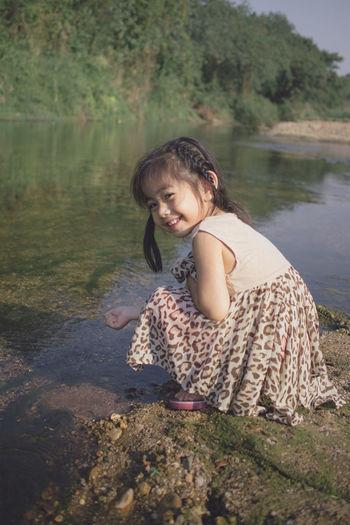 Portrait of smiling girl in lake