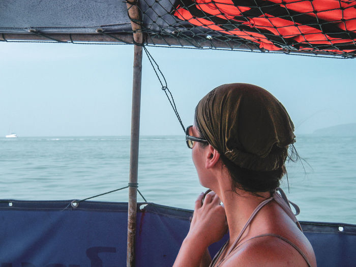 Boat trip Eyeemphotography Travel Destinations Water Sea Thailand Nautical Vessel Real People Headshot One Person Glasses Portrait Sunglasses Lifestyles Leisure Activity Young Adult Sailboat Outdoors Transportation Looking Mode Of Transportation Day Nature