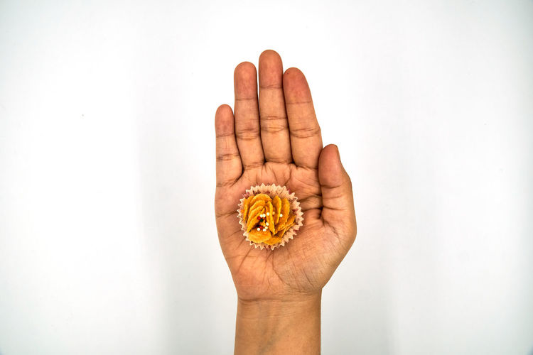 Directly above shot of person holding hand against white background