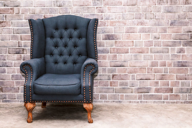 Modern armchair furniture with brick wall in room interior Absence Architecture Armchair Brick Brick Wall Built Structure Chair Comfortable Cozy Domestic Room Empty Flooring Furniture Indoors  Leather Living Room Luxury No People Pattern Seat Sofa Wall Wall - Building Feature