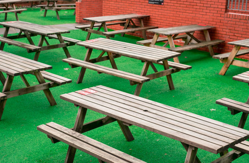 Unreal: an empty terrace of a bar in Glasgow. Glasgow  Lines Minimalist Architecture Picnic Pub Scotland Travel Travel Photography United Kingdom Bar Beergarden  Day Drinking Empty Europe Fujifilm Green Color Minimalism No People Outdoors Street Photography Streetphotography Table Urban Wood - Material