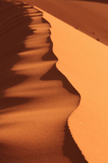 Africa Arid Climate Desert Focus On Shadow Full Frame In A Row Landscape Mountain Namibia Nature Nature Photography No People Outdoors Road Road Marking Sand Sand Dunes Shadow Structure And Nature Structures & Lines Sunlight Surface Level Tranquil Scene Waves