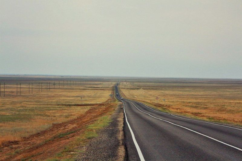 Gray Mainly Cloudy Road Steppe Expanse Kalmykia Nature Plain Track Travel Дорога Калмыкия пасмурно путешествия равнина степь трасса Adapted To The City Let's Go. Together. Been There.
