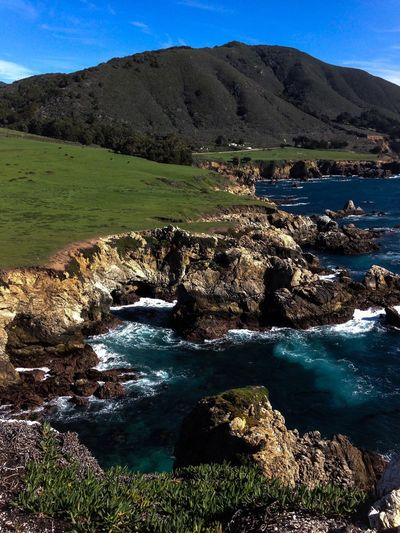 """Picture by the sea of California and """"Highway 1""""🎥 Nature Water Beauty In Nature Scenics Landscape Tranquil Scene Day Outdoors Tranquility No People Mountain Sky Grass 12MP Lost In The Landscape"""