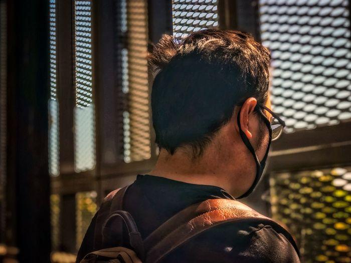 Rear view portrait of man gazing out