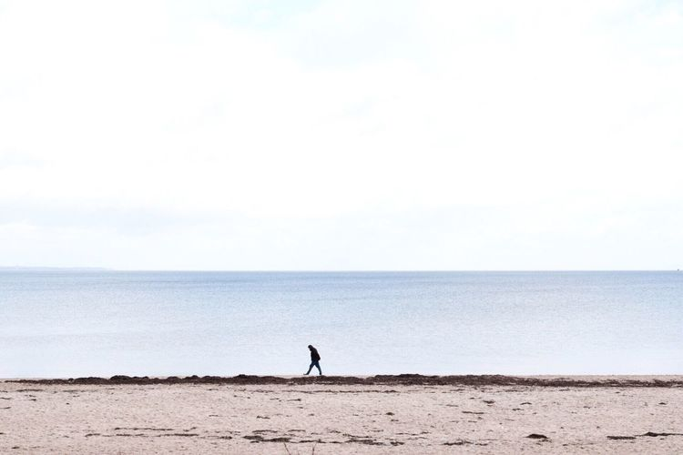 Person Walking On Shore At Baltic Sea