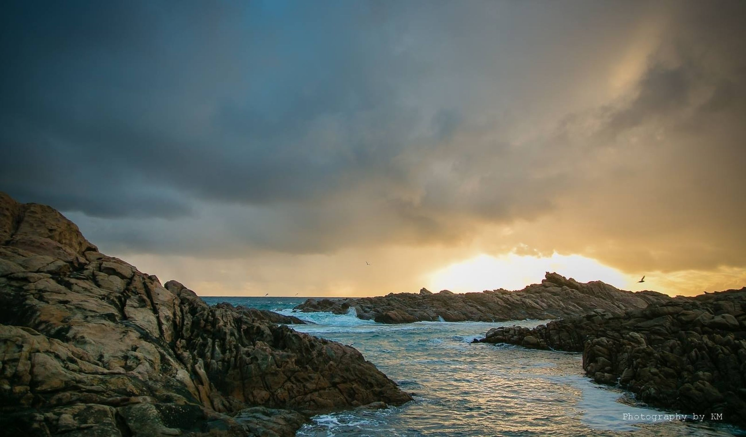 water, sea, scenics, sky, tranquil scene, beauty in nature, tranquility, sunset, rock - object, cloud - sky, nature, rock formation, horizon over water, idyllic, cloudy, cloud, rock, cliff, outdoors, waterfront