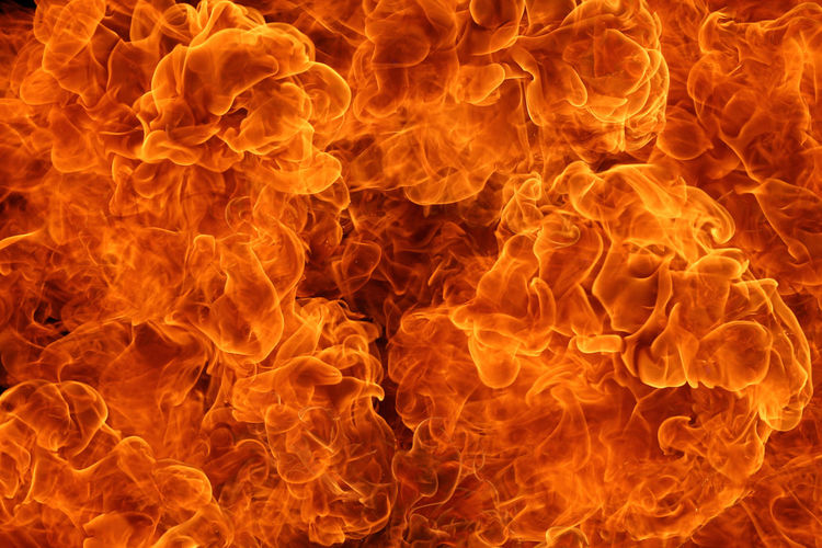 Close-up of red fire against black background